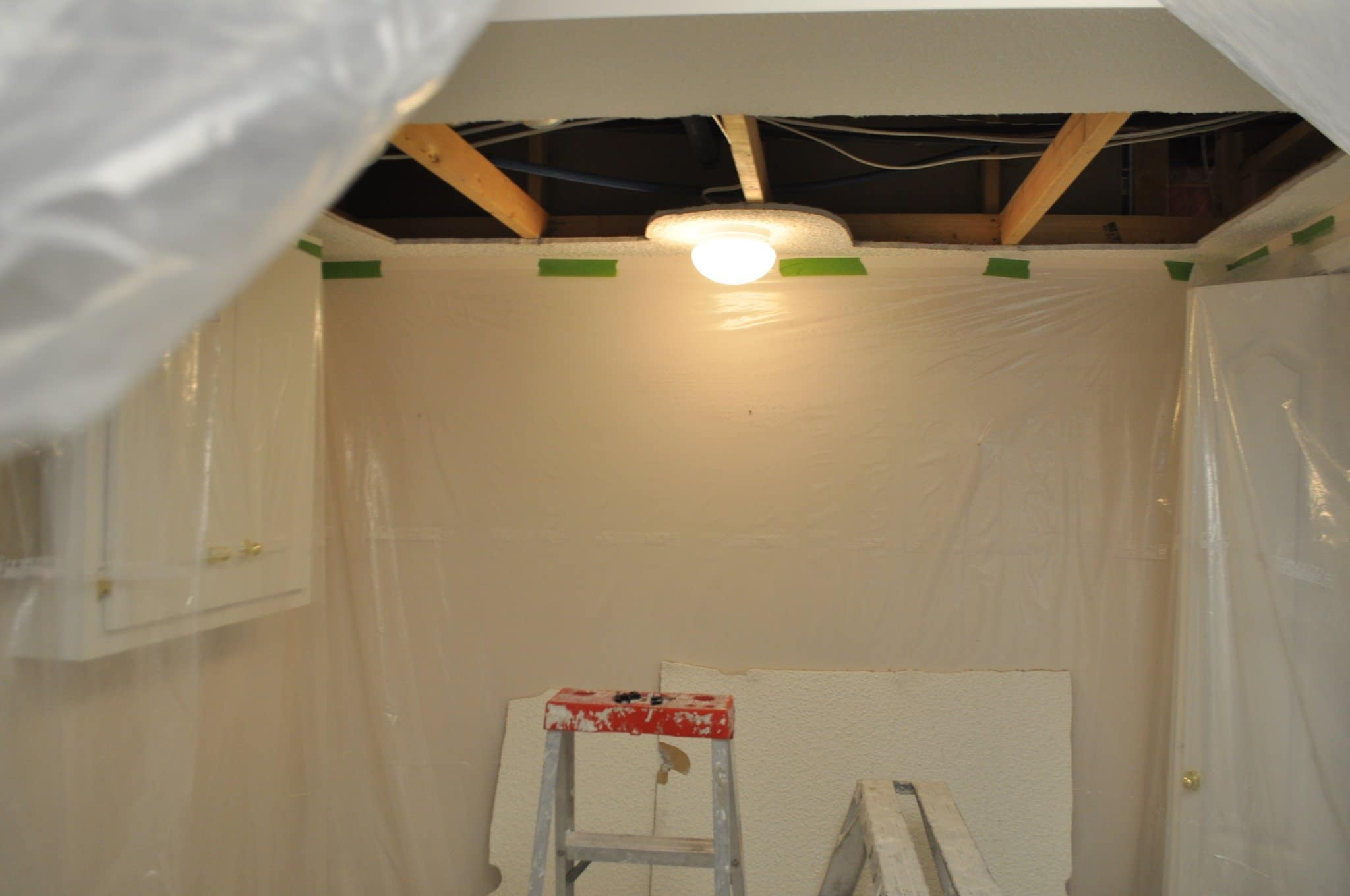A picture showing the holes that have to be cut in the ceiling and drywall to access and replace the poly b pipes.